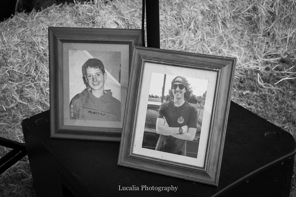 framed photographed of absent loved ones at a wedding