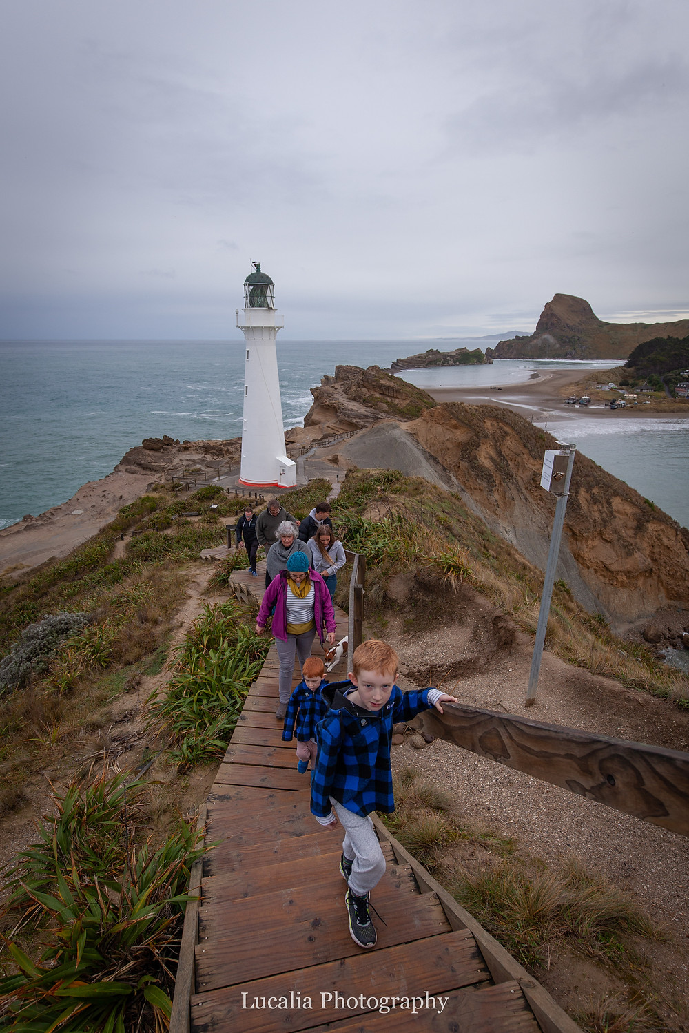 walking past the lighthouse at Castlepoint Wairarapa family photographer