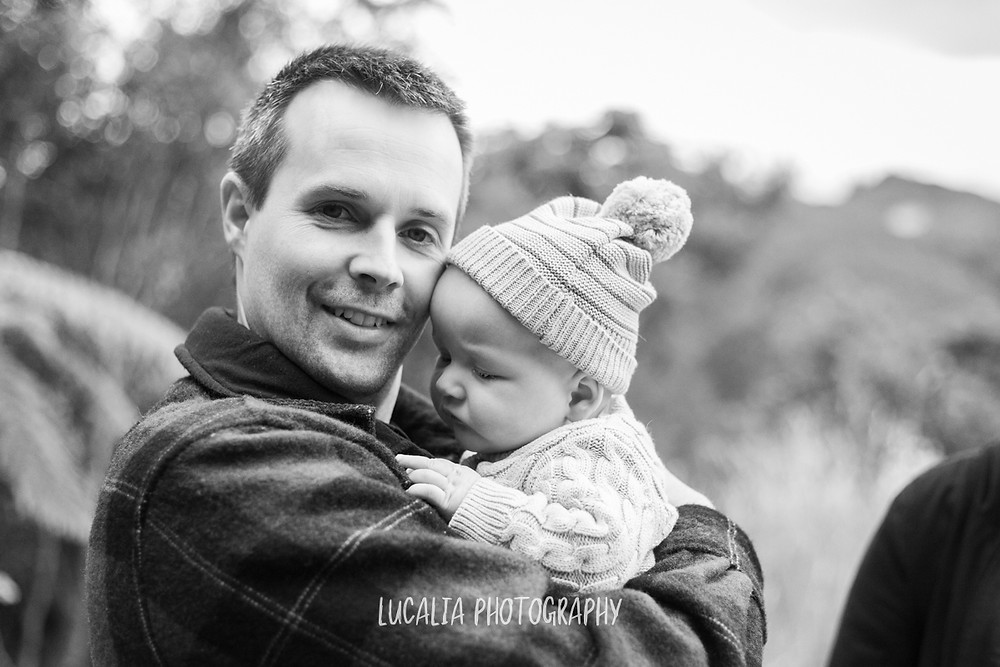 dad hugging baby with winter beanie, Mount Holdsworth, Wairarapa family photographer