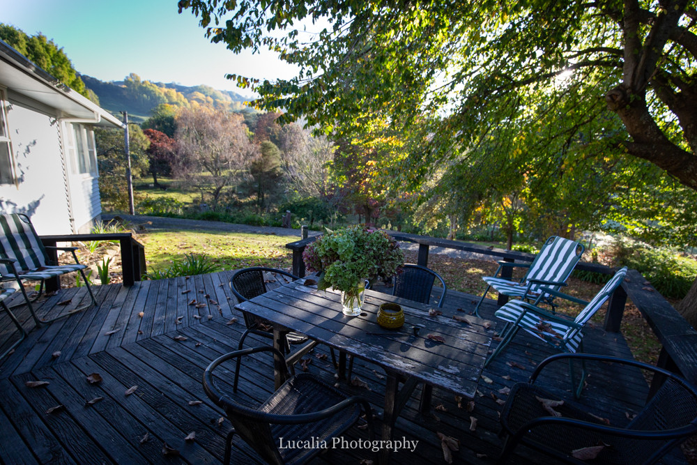 leafy outdoor eating area with garden views, High Peaks Farm Stay, Mangamahu, Manawatu-Wanganui, New Zealand