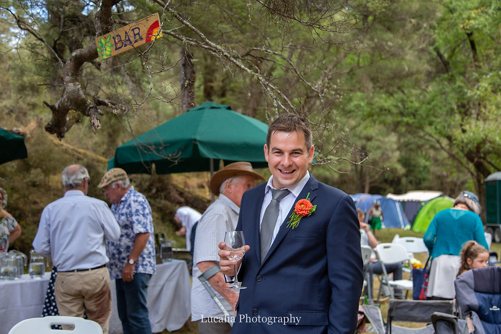 groom at bar of his forest wedding reception, Wairarapa wedding photographers