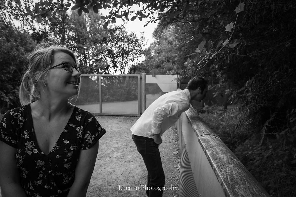 engaged couple looking at Tuatara, Zealandia, Wellington