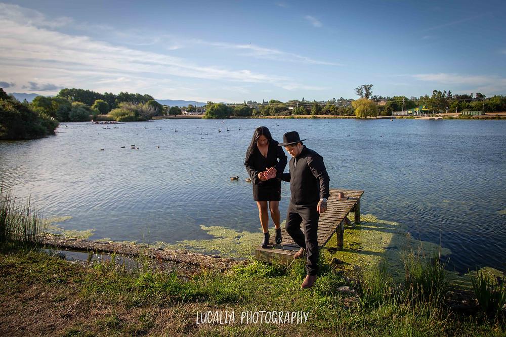 couple walking along jetty in Henley Lake, Wairarapa wedding photographer