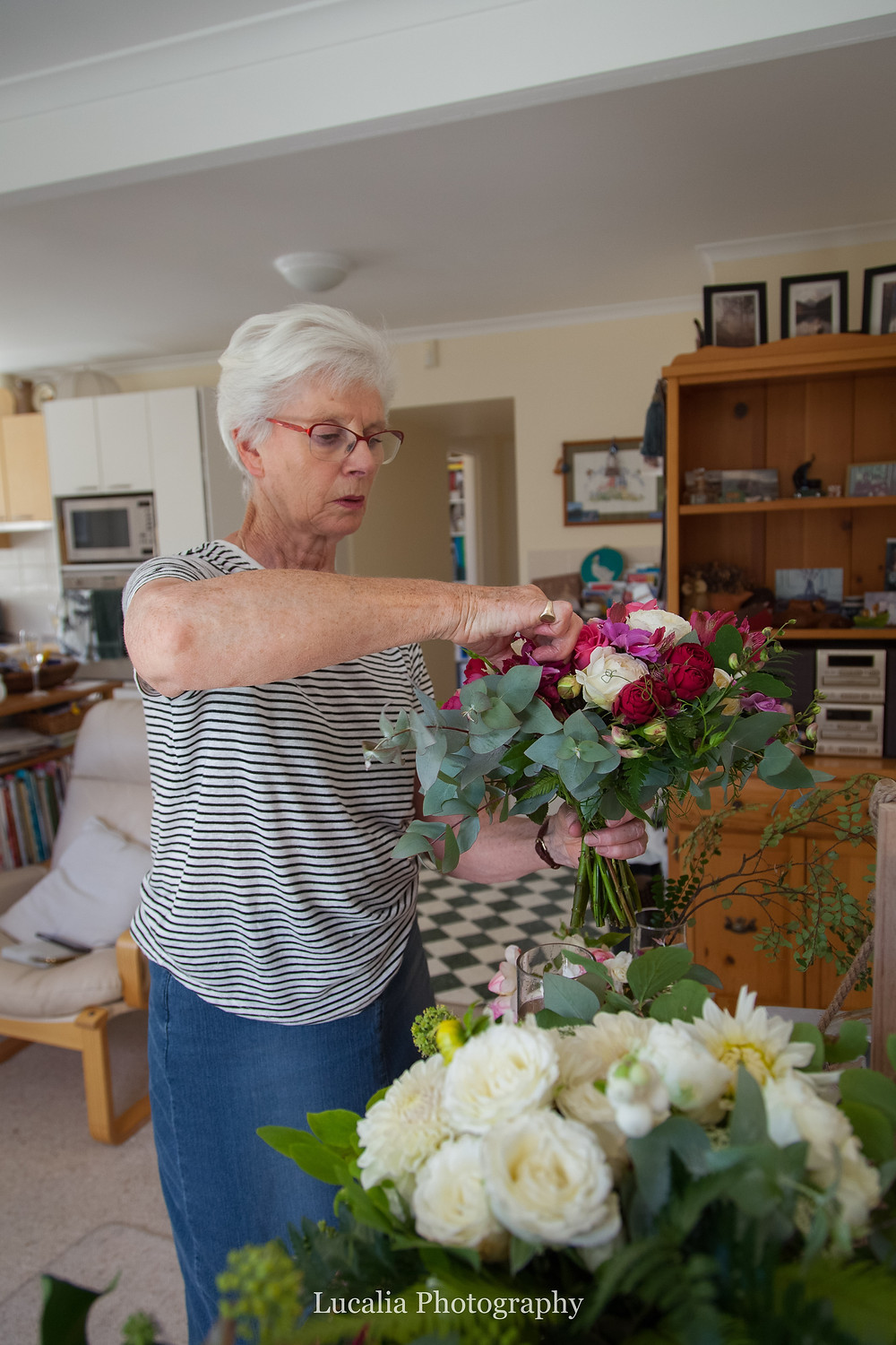 mother of the bride helping with wedding flowers, Wairarapa wedding photographer