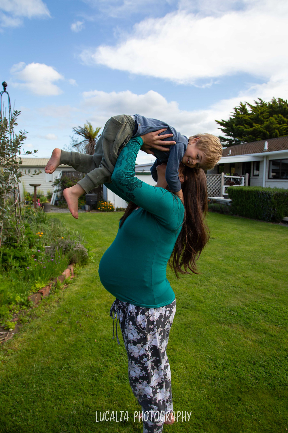 pregnant mum lifts son abover her head, Wairarapa maternity photographer