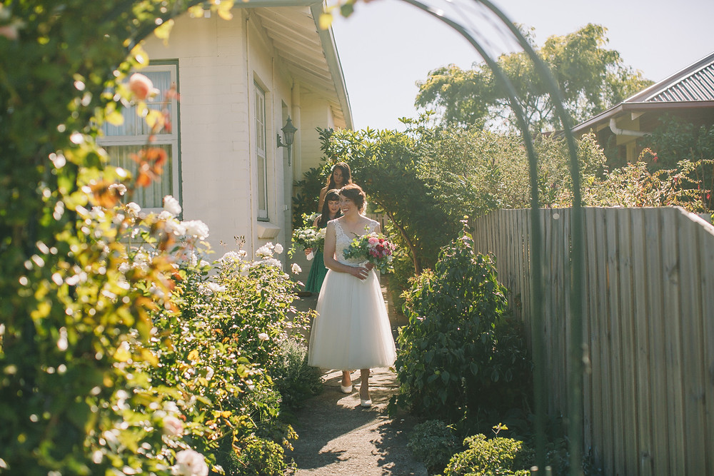 tea-length wedding dress in rose garden, Wairarapa