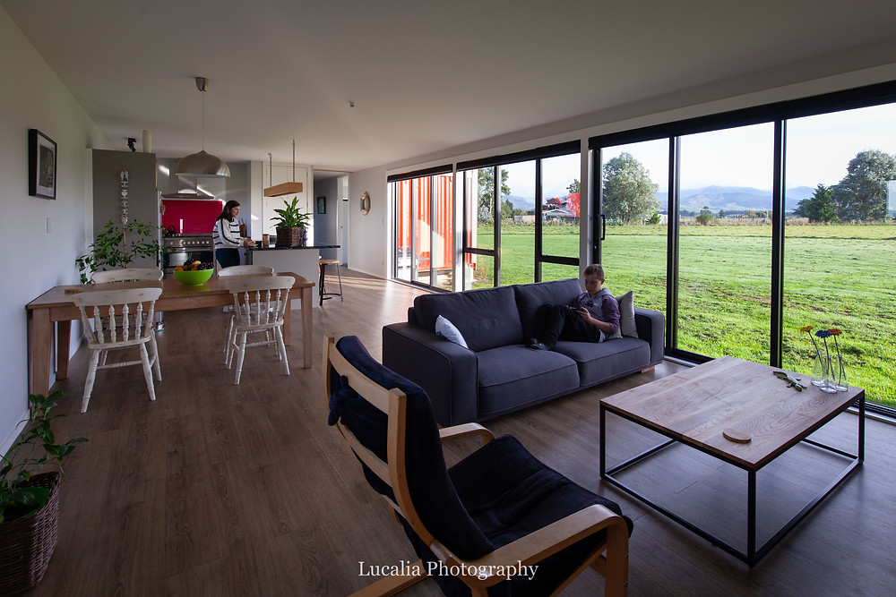 open plan lounge, dining and kitchen area of eco-friendly family container home, Wairarapa