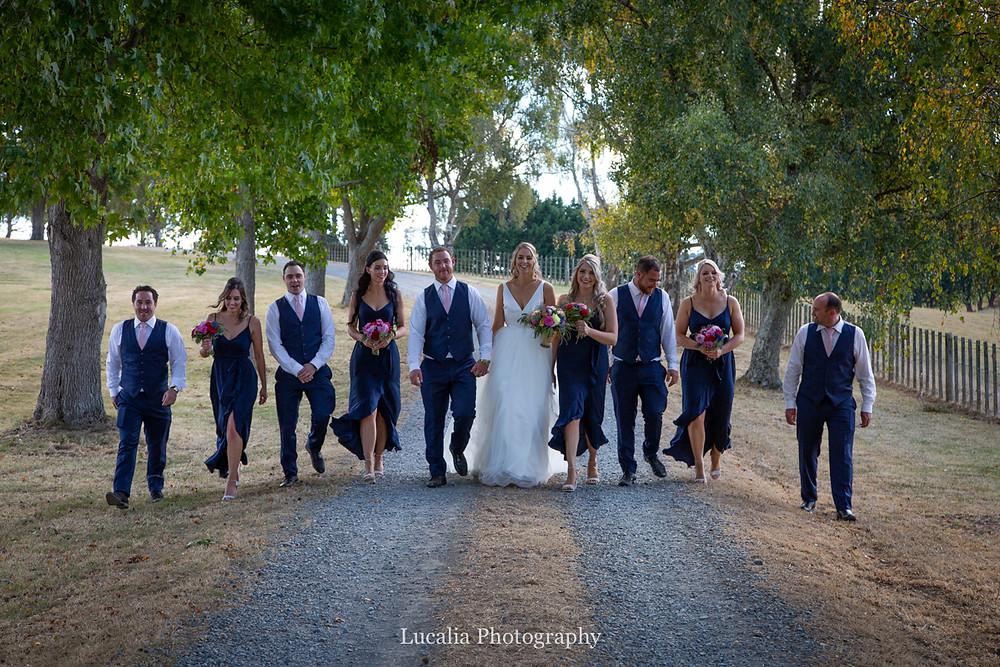 wedding party walking in a garden, Wairarapa
