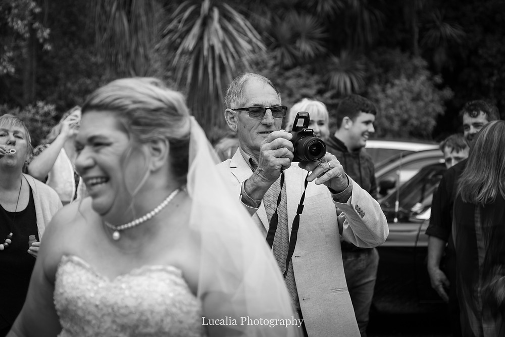 father of the bride taking photos at his daughters wedding, Wairarapa wedding photographer