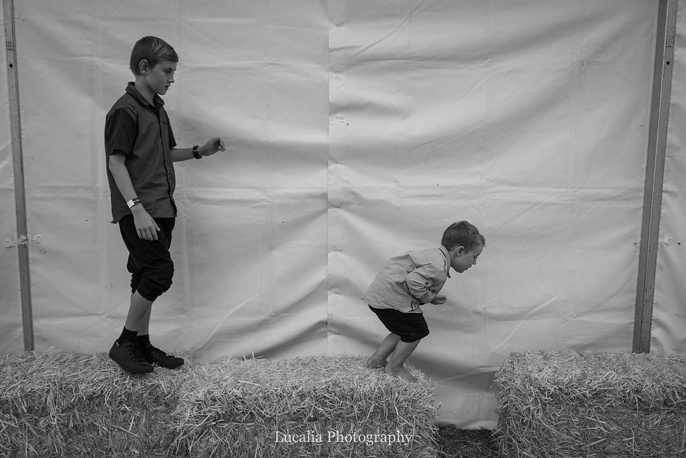 children jumping on bales of hay, Wairarapa