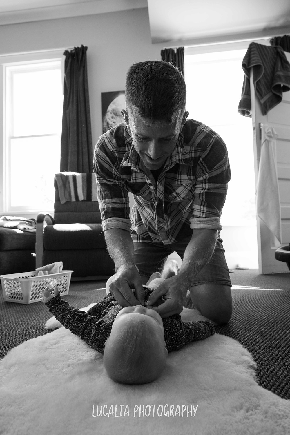 dad changing daughter on the floor at home, Wairarapa family photographer
