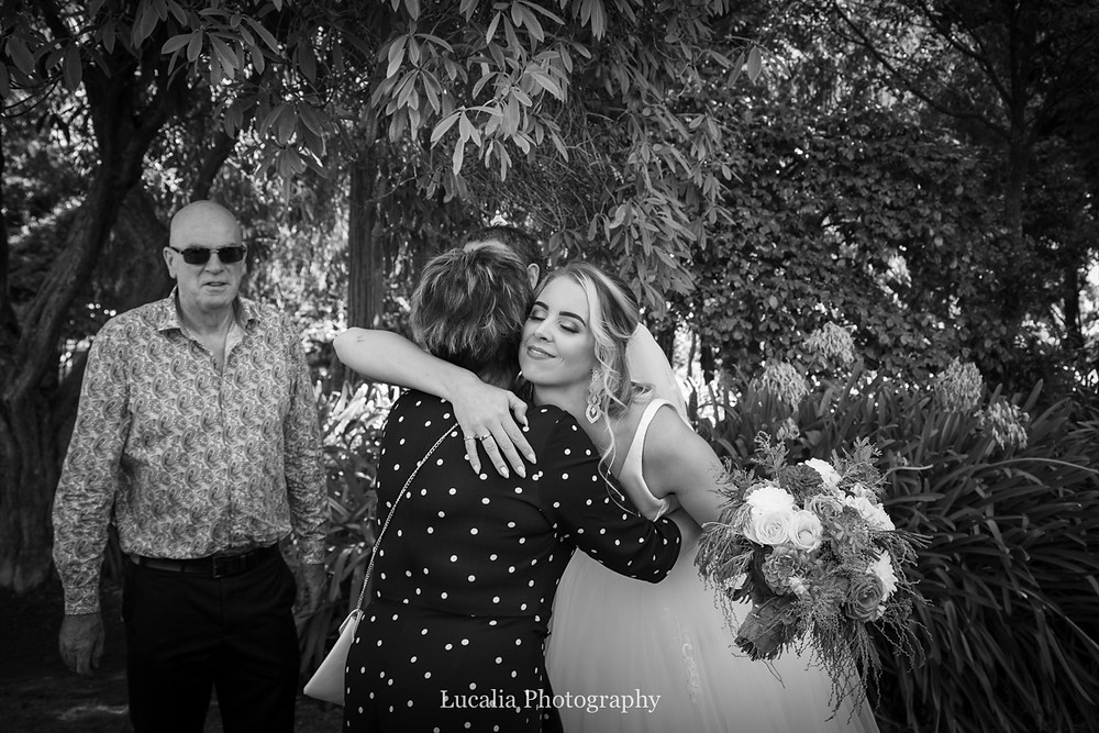bride hugs wedding guests, Wairarapa