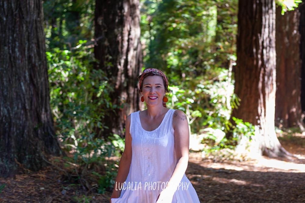 Wairarapa wedding celebrant Aingie Miller walking in a white dress at Pūkaha National Wildlife Centre
