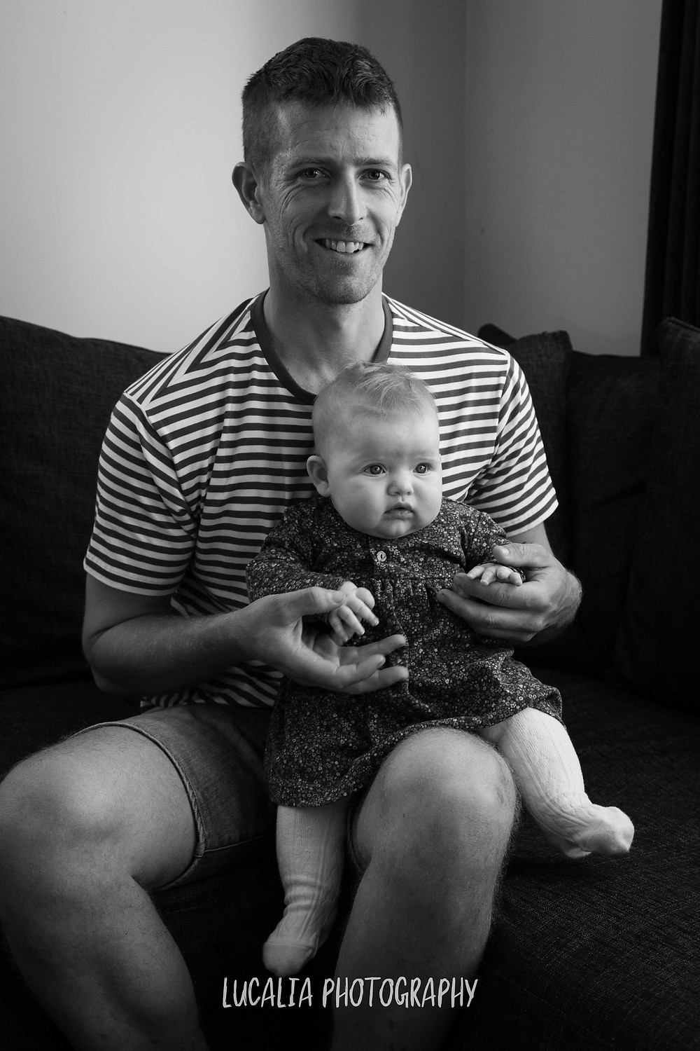 father holding daughter on his lap, Wairarapa family photographer