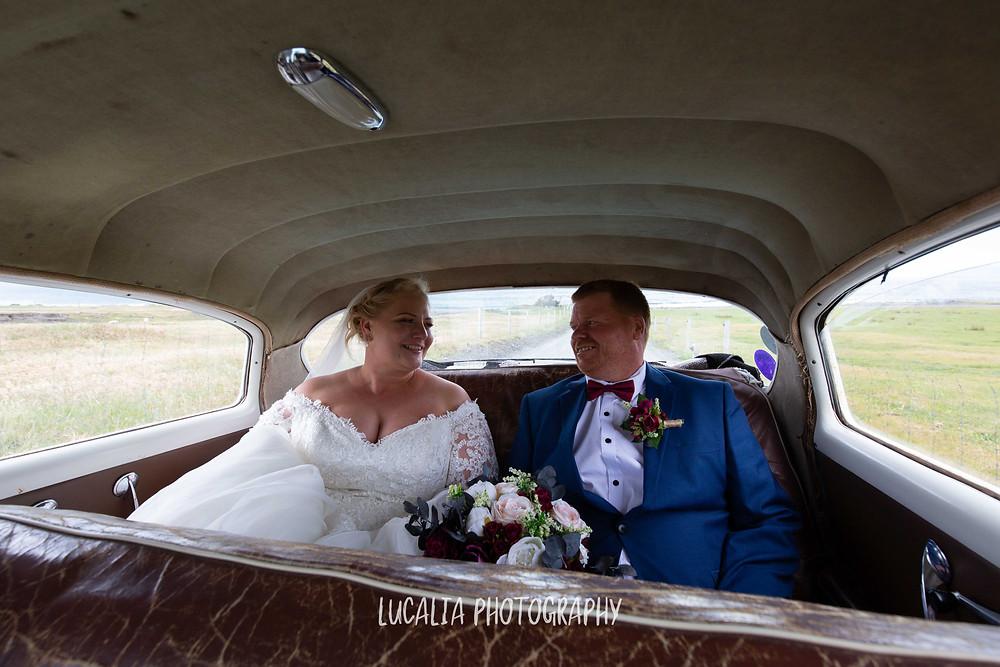 bride and groom in backseat of wedding car, Waimeha Camping Village wedding venue, Ngawi, Wairarapa wedding