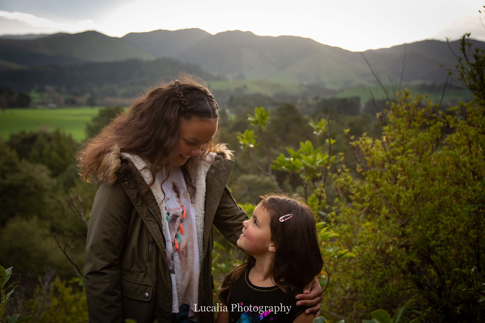 sisters laughing with mountains in the background, Wairarapa family photographer