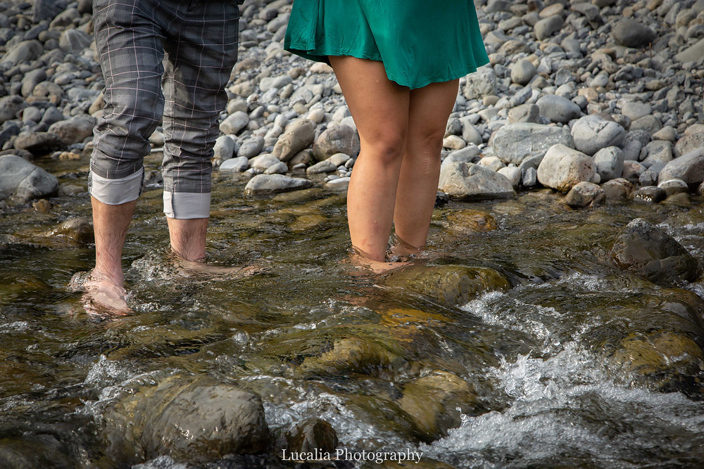 engaged couple's feet in a running river, Wairarapa