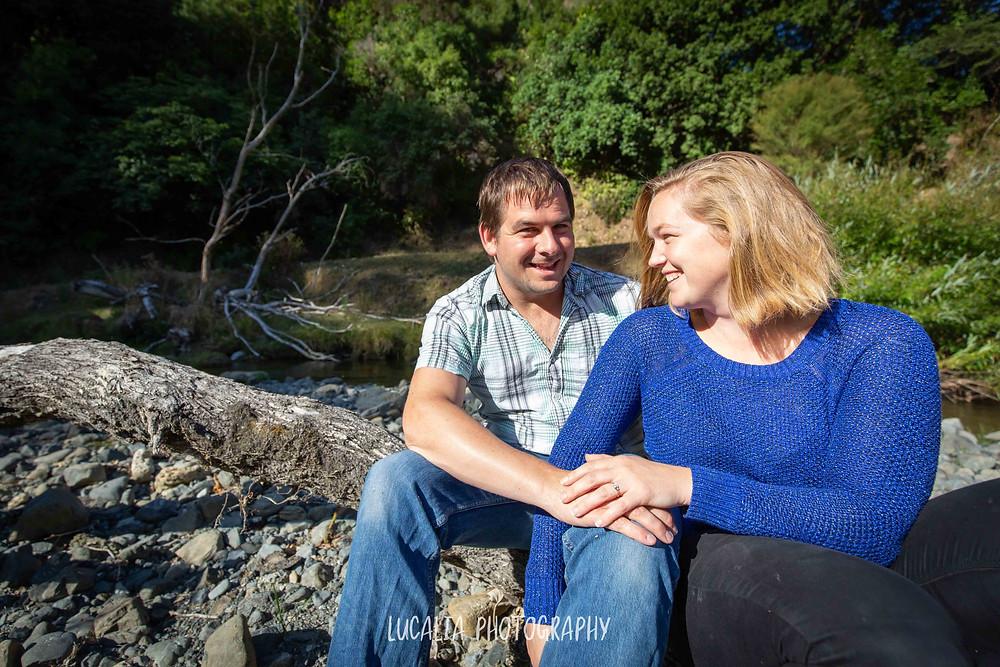 engaged couple and engagement ring near river, Martinborough Wairarapa wedding photographer