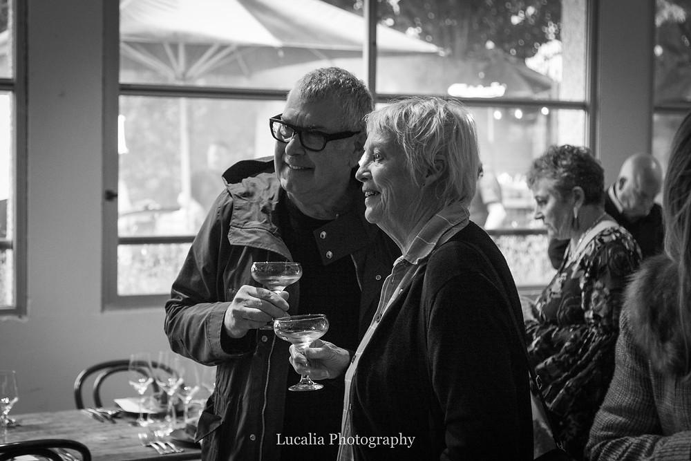 guests smiling holding wine glasses at Rose & Smith at Tauherenikau Wairarapa wedding venue