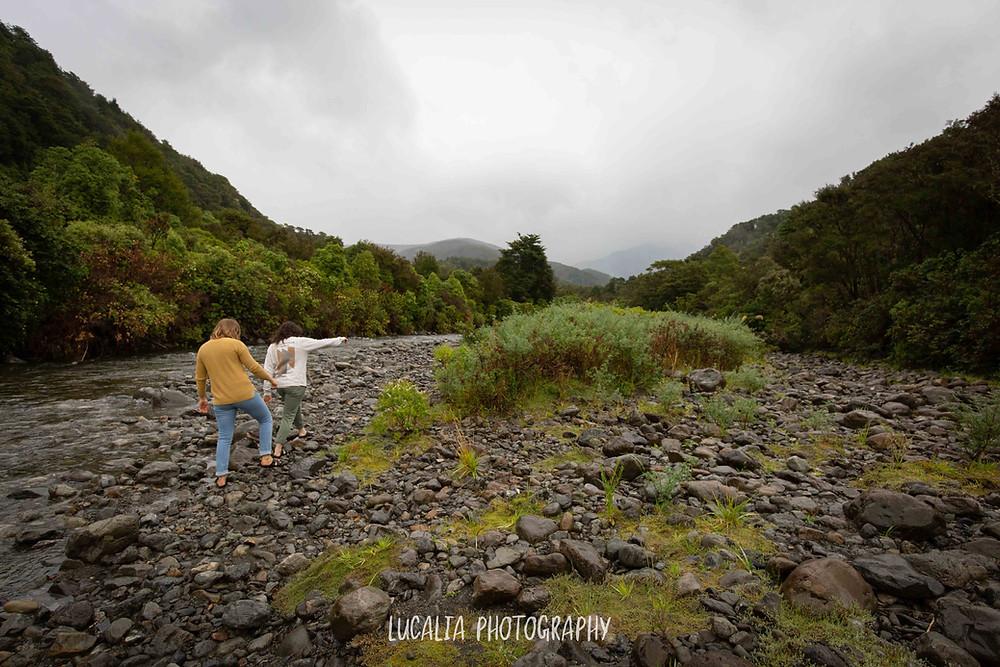 engaged couple walking away along river bank, Mt Holdsworth Wairarapa, photographer