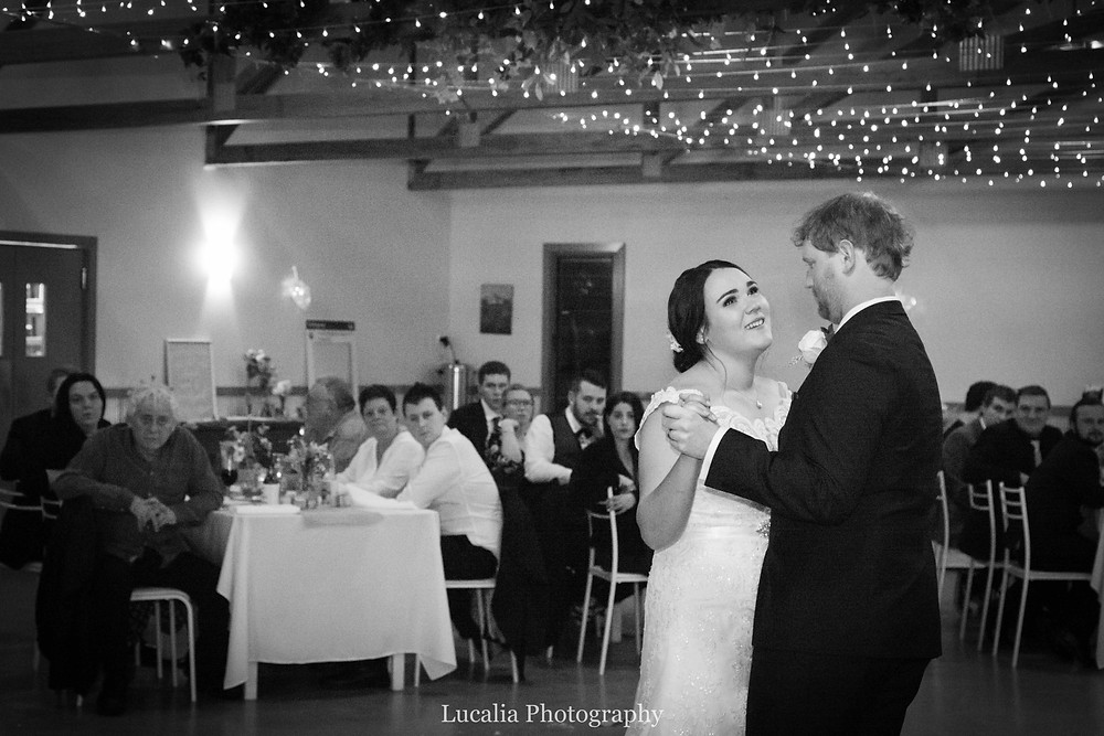 bride and groom dancing watched by guests at their wedding reception, Lucalia Photography