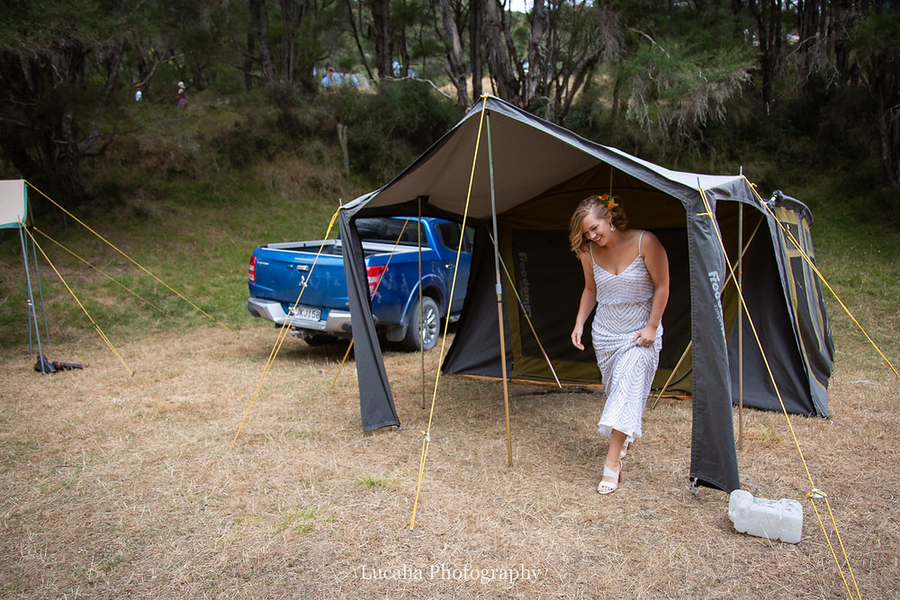 bride walking out of her tent at camping wedding reception, Wairarapa wedding photographers