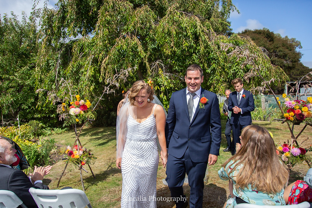 bride and groom walking back down the aisle, Wairarapa wedding photographers