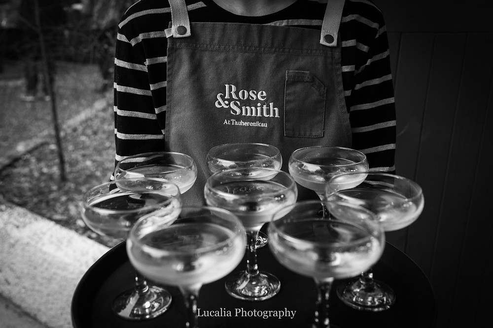 sparkling wine being served by staff at Rose & Smith at Tauherenikau Wairarapa wedding venue
