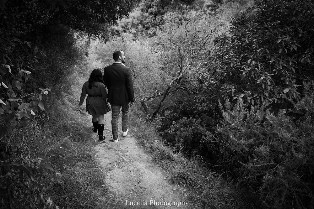 engaged couple walking down a path in Tararuas, Wairarapa
