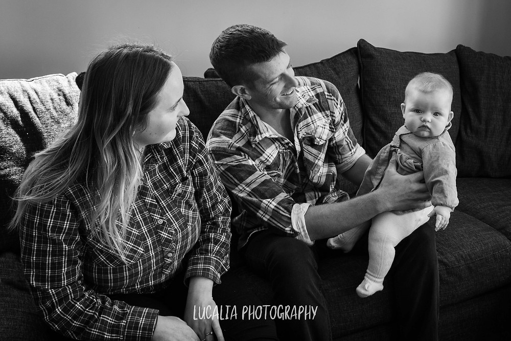 family with baby daughter on the couch at home, Wairarapa family photographer