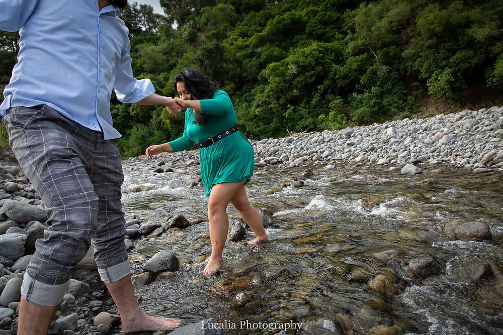 husband to be helping his fiancee cross a river, Wairarapa