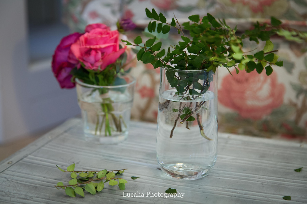 fagus leaves and pink roses in glasses of water, Wairarapa wedding photographer