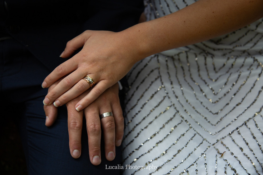 married couple's hands wearing wedding rings, Wairarapa wedding photographers