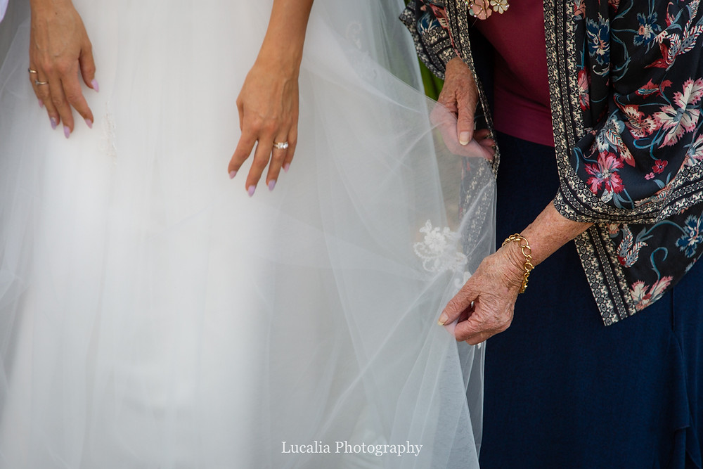 bride and grandmother touch wedding dress, Wairarapa