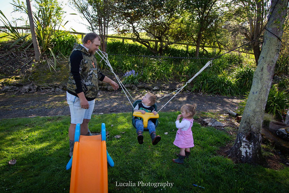 Dady playing with children on swing, Wairarapa family photographer