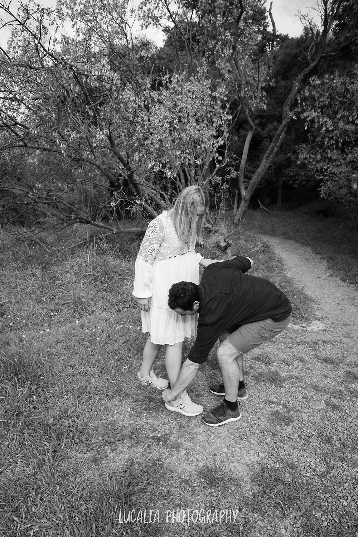 guy helping his pregnant partner put on her shoes, Wahi Falls, Tararua, Lucalia Photography