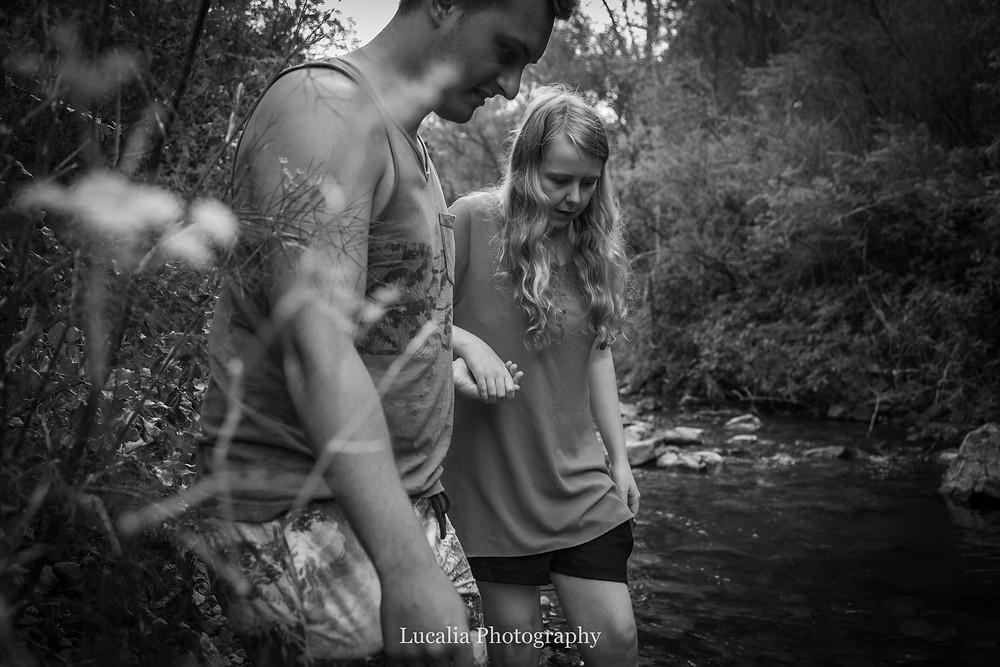engaged couple holding hands walking along a river bank, Featherston Wairarapa