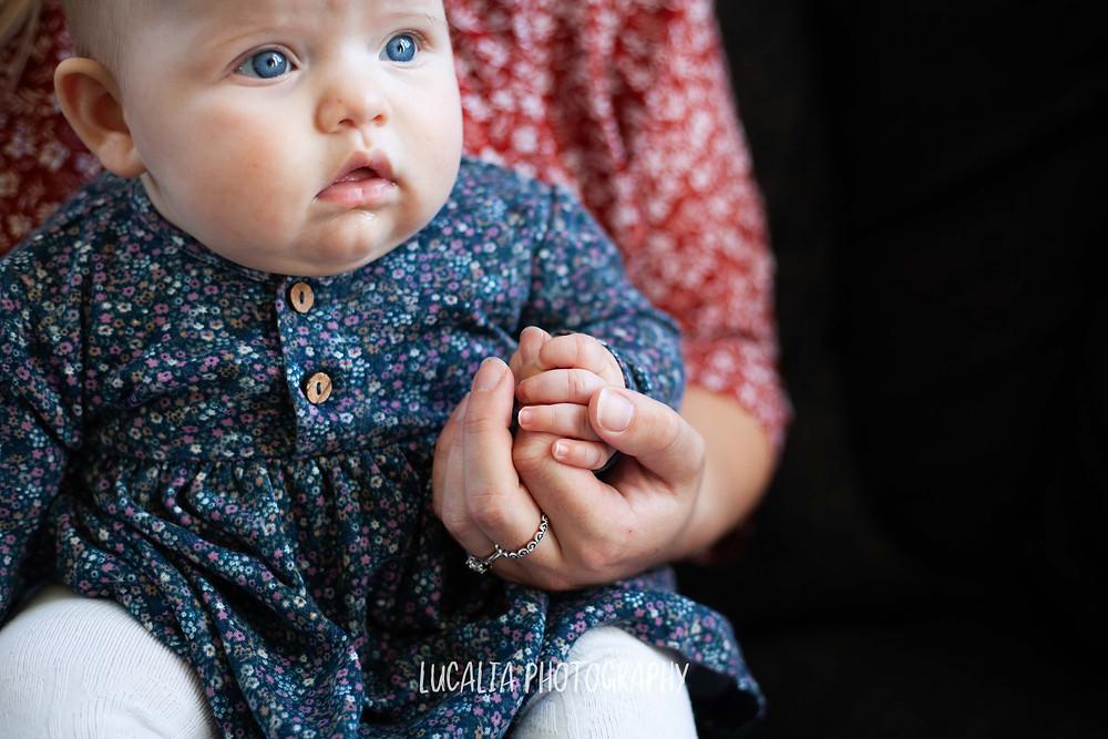 daughter sitting holding mum's finger, Wairarapa family photographer