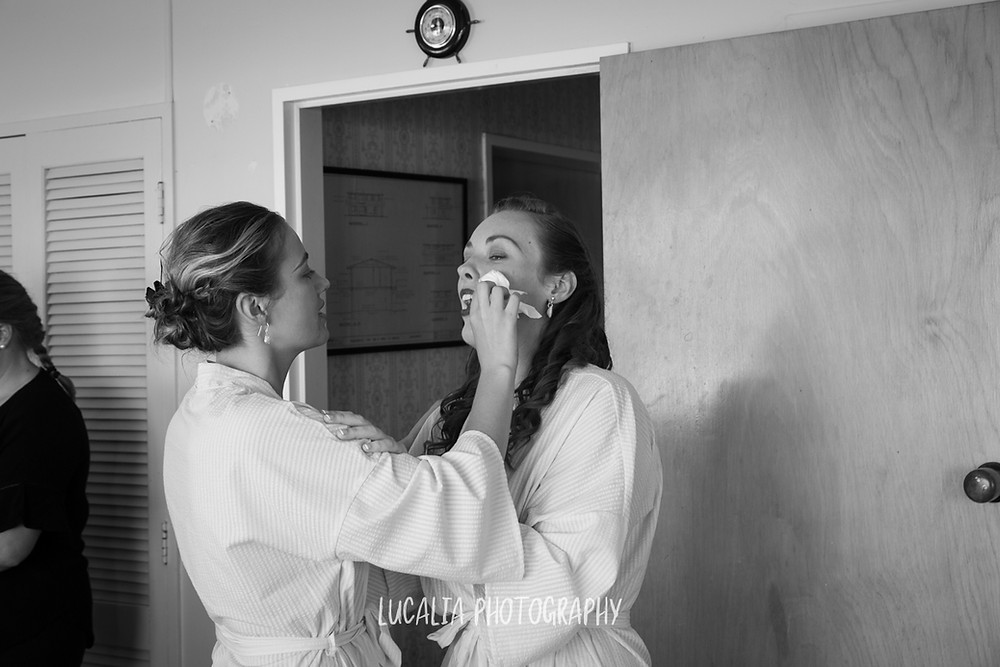 bridesmaid wipes away tears from the bride, Castlepoint Wairarapa wedding, Lucalia Photography
