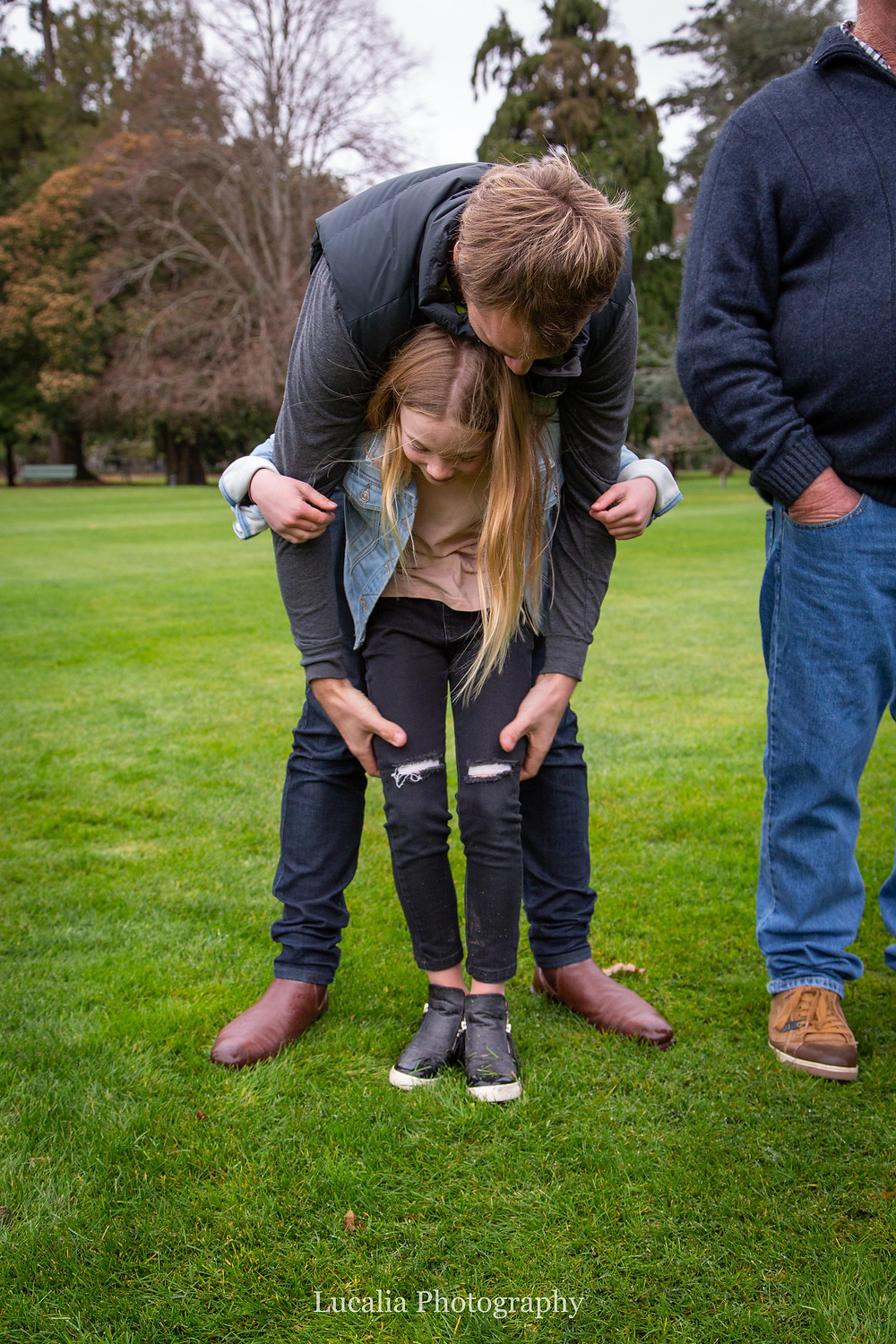 uncle playing with his niece in Queen Elizabeth Park, Wairarapa family photographer