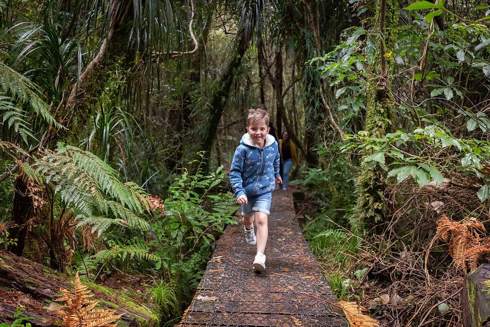 boy running on a boardwalk, Waiohine Gorge, Wairarapa family photographer