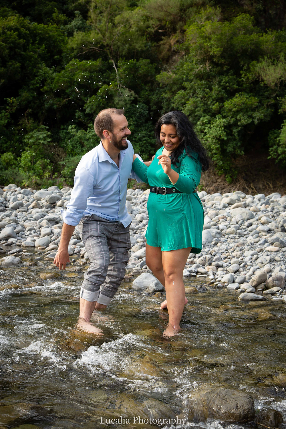 engaged couple standing laughing in a river, Wairarapa wedding photographer