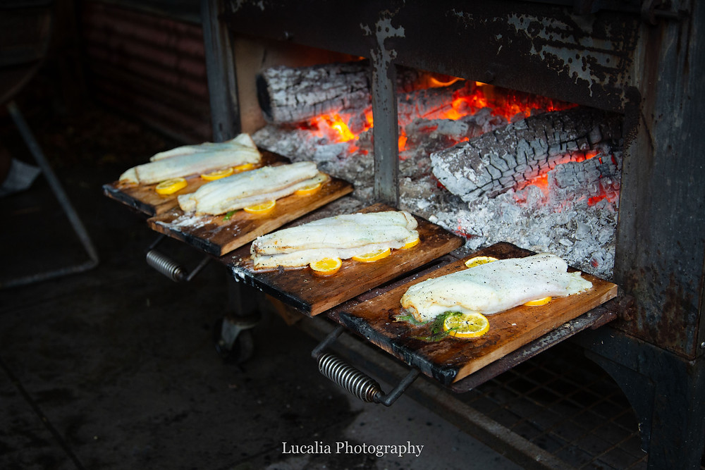 fish about to be cooked in an outdoor wood fired oven at Rose & Smith at Tauherenikau Wairarapa wedding venue