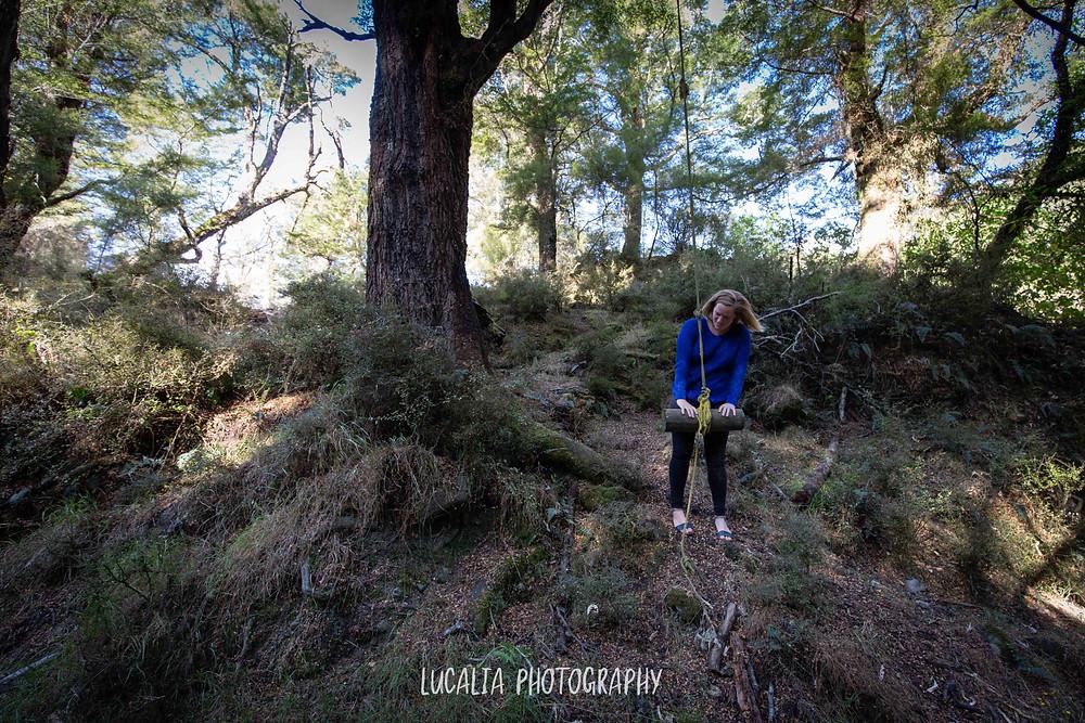 lady playing with swing tied to a tree, Martinborough Wairarapa wedding photographer