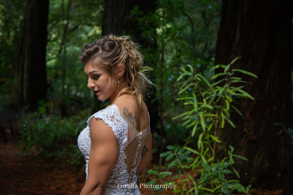 bride looking down in the forest at Pukaha National Wildlife Centre, Wairarapa wedding venue