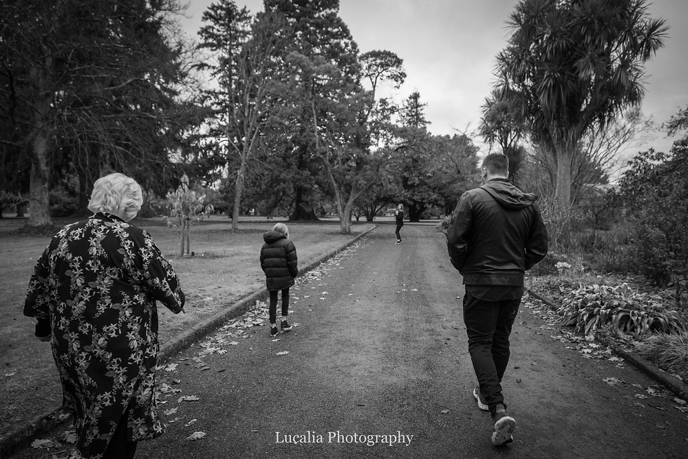 family walking down a path in Queen Elizabeth Park, Wairarapa family photographer