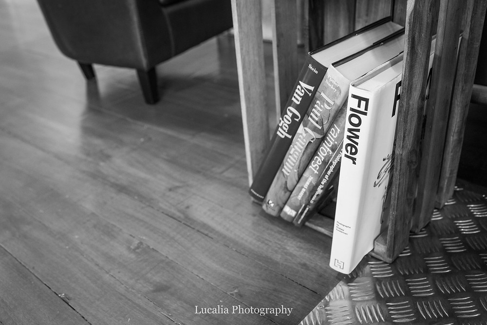 art books in a crate on the floor, Wairarapa photographer