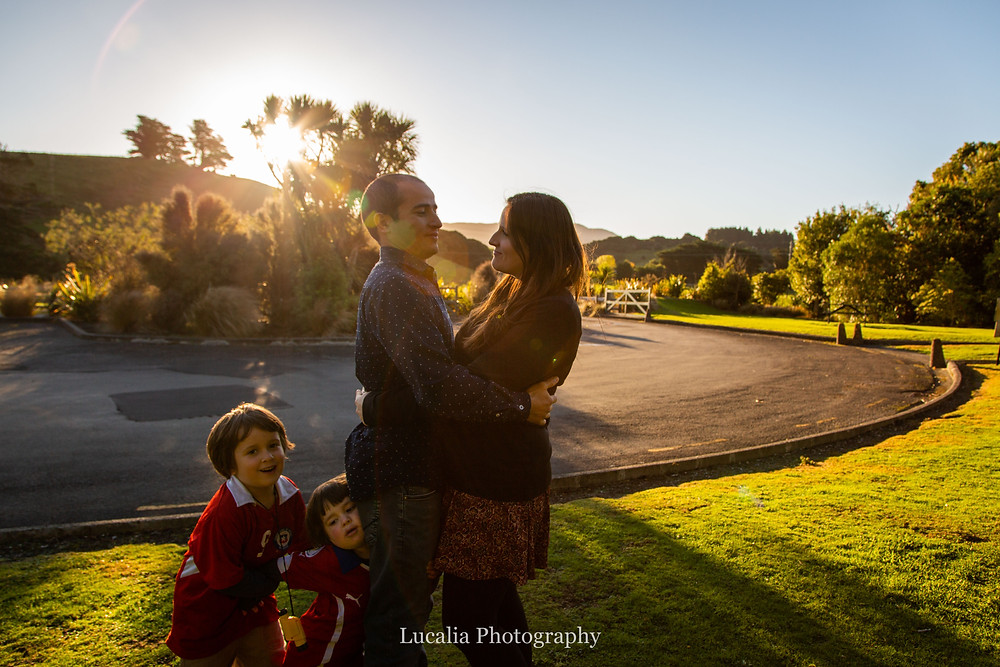 parents hugging with children hugging their legs, Wairarapa family photographer