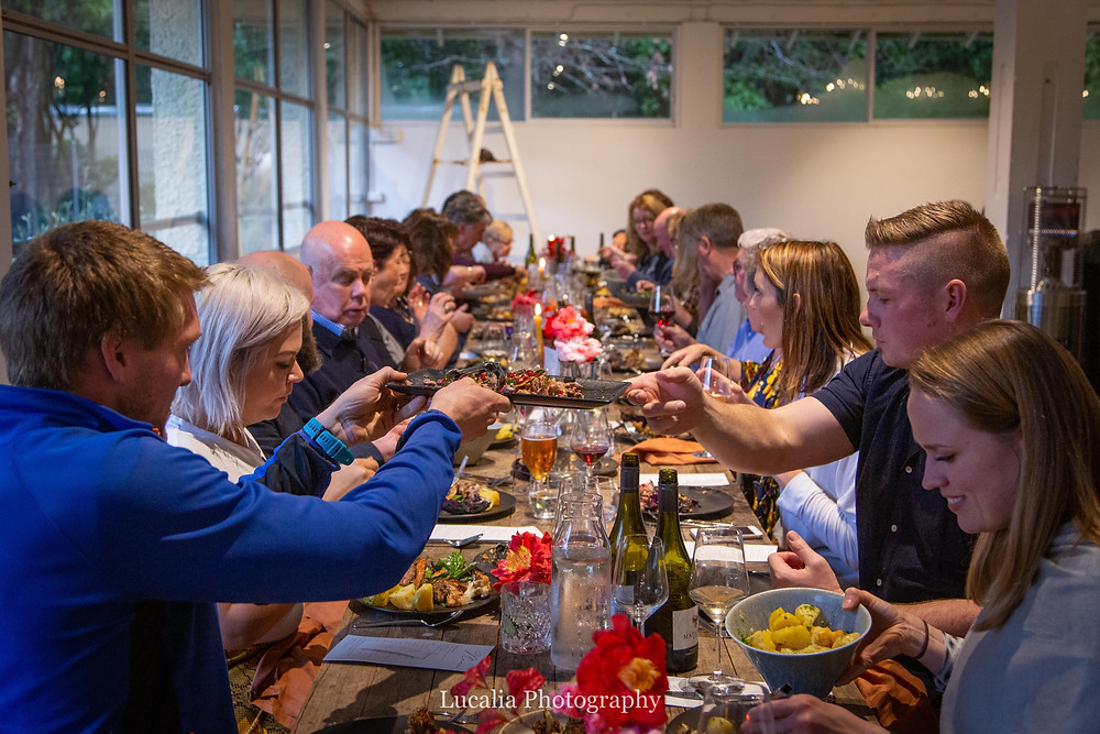 passing food across a full table, Rose & Smith at Tauherenikau Wairarapa wedding venue