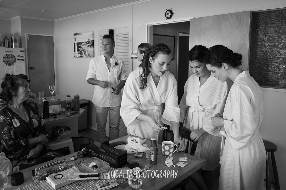 bride and her bridesmaids getting ready, Castlepoint Wairarapa wedding, Lucalia Photography
